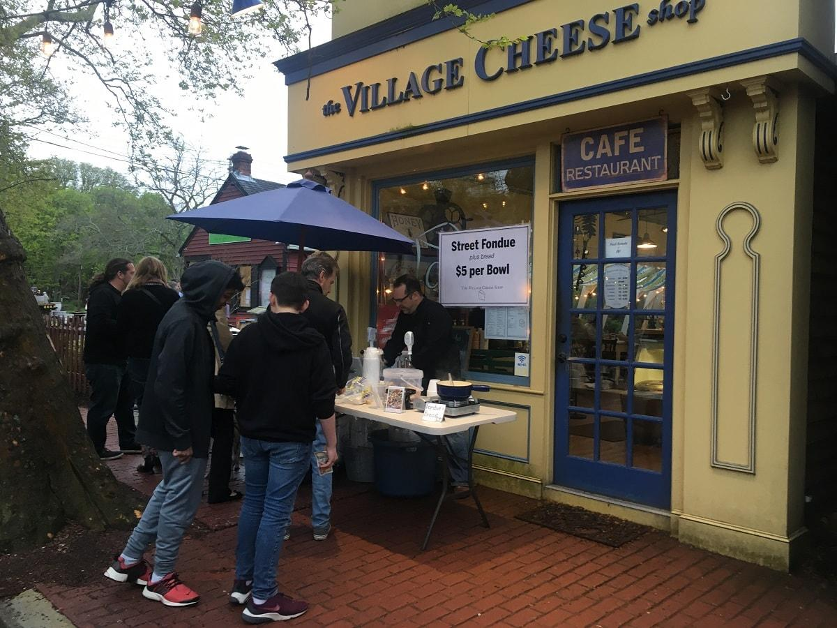First Fridays 3 – Serving up fondue and Rose at the Village Cheese Shop-min