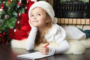 children writing list to santa christmas