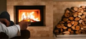 cocktail by the fireplace