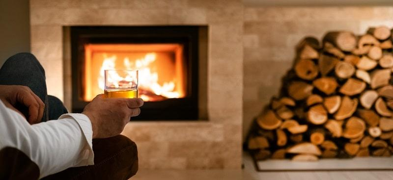 winter vacation cocktail by the fire