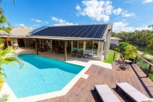 swimming pool and house with solar panels eco-friendly