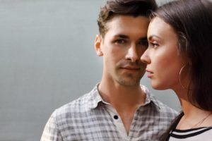 woman and man close together brown hair