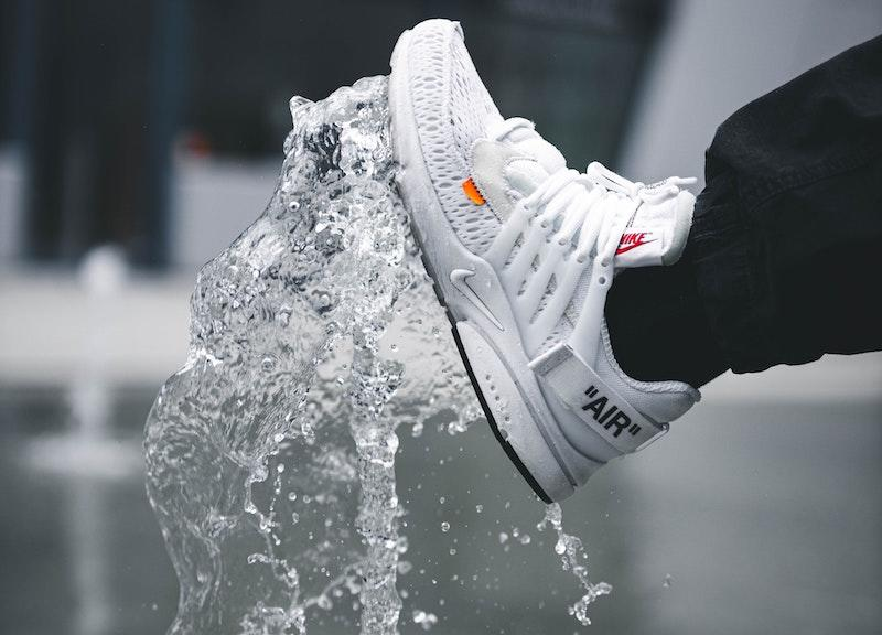 luxury white sneaker splash up white water