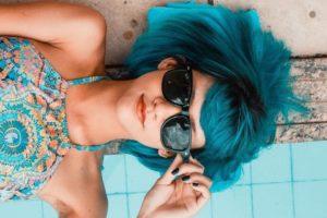 woman at pool blue hair